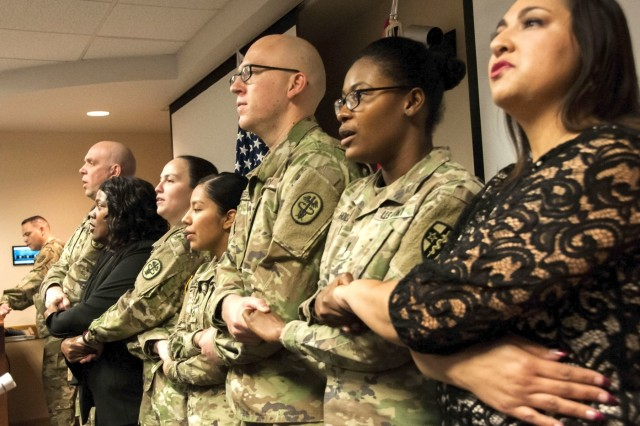 "William Beaumont Army Medical Center Soldiers and staff join hands during a rendition of the gospel song ""We Shall Overcome,"" during the annual Martin Luther King Jr. Day observance at WBAMC, Jan. 19. The observance celebrated the life and accomplishments of Dr. Martin Luther King, Jr. and his impact on today's culture."