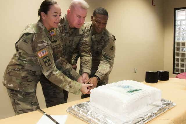 (From left) Command Sgt. Maj. Janell Ray, command sergeant major, William Beaumont Army Medical Center, Col. Erik Rude, commander, WBAMC, and Command Sgt. Maj. Reginald Gooden, deputy director and assistant dean of Sergeants Major Education, U.S. Army Sergeants Major Academy, Fort Bliss, Texas, cut a cake in celebration of WBAMC's annual Martin Luther King Jr. Day observance at WBAMC, Jan. 19.
