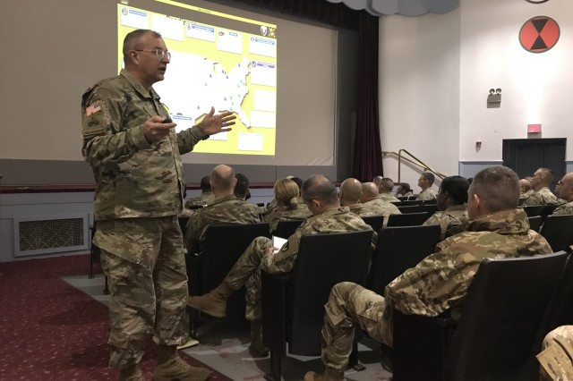 Maj. Gen. Clark W. LeMasters Jr. explains the structure and mission of Tank-automative and Armaments Command to Soldiers attending the Joint Base Lewis-McChord Sustainment Warfighter Forum Jan. 24, 2018, at McChord Theater. LeMasters, the commanding general of TACOM, visited the Pacific Northwest Army and Air Force base to attend the Stryker Summit as well as talk to leaders and sustainers about how his organization can support Army readiness. (Army photo by Capt. Cain Claxton)
