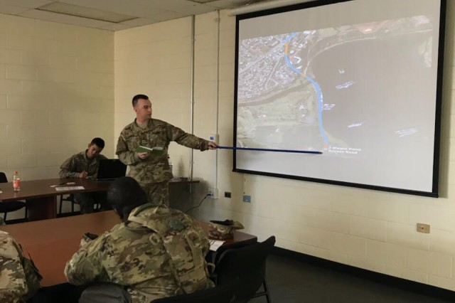 1st Lt. Reed Honken, distribution platoon leader of the 84th Engineer Battalion's FSC, reviews convoy route plans during the unit's deployment readiness exercise. Supporting the Army's top priority of readiness, the event ensured Soldiers have the training they need to deploy, fight and win across the entire spectrum of conflict. (U.S. Army photo by 1st Lt. Eugene T. Molisso)