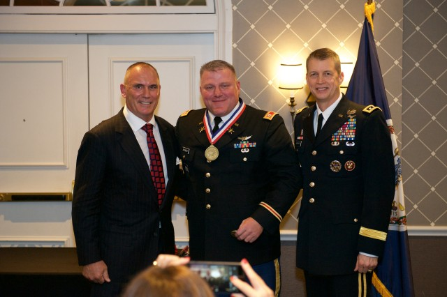 Riki Ellison, the Missile Defense Advocacy Alliance chairman and founder, left, Capt. Jason Brewer, the 2017 National Guard Missile Defender of the Year, center, and U.S. Army Lt. Gen. Daniel R. Hokanson, stand for a photo at the MDAA Missile Defender of the Year ceremony in Alexandria, Virginia, Jan. 12, 2018.