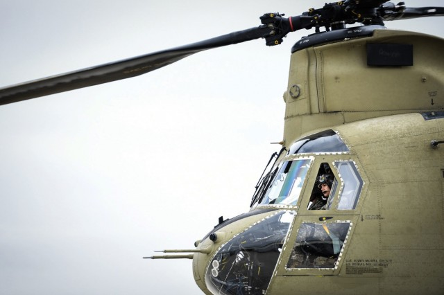 Chief Warrant Officer Natalie Miller, assigned to Company B, 2-238th General Support Aviation Battalion, leaves Greenville, South Carolina, in February 2017 aboard a CH-47F Chinook heavy-lift cargo helicopter, bound for a weeklong training mission focused on high-altitude flight operations. FVL platforms will need to operate at extended ranges and endure difficult conditions longer and with less-frequent maintenance. (U.S. Army photo by Staff Sgt. Roberto Di Giovine)
