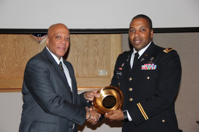 Maj. Dalmar Jackson (right), deputy commander for administration, Medical Department Activity - Alaska, thanks Reverend Darrell Jarmon for serving as guest speaker during the 2018 Dr. Martin Luther King Jr. Observance at Northern Lights Chapel Jan 11. Jarmon urged attendees to carry on Dr. King's philosophy of service.