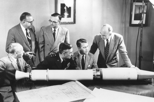 Members of the Explorer 1 team, America's first Earth satellite which was launched Jan. 31, 1958. Seated in the center and on the right are Maj. Gen. John B. Medaris, U.S. Army Ballistic Missile Agency commander, and Dr. Wernher von Braun, ABMA technical director.