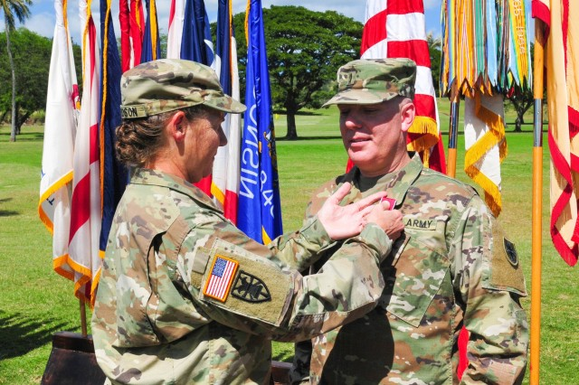 Chief Warrant Officer 5 Mark Parr, the 8th Theater Sustainment Command's outgoing command chief warrant officer, is awarded the Legion of Merit from Maj. Gen. Susan A. Davidson, the 8th TSC's commanding general, during a change of responsibility ceremony January 29, 2018 at Fort Shafter, Hawai'i. During the ceremony, the 8th TSC officially welcomed CW5 Ronald Panter as its new command chief warrant officer. (U.S. Army photo by Sgt. 1st Class Michael Behlin)