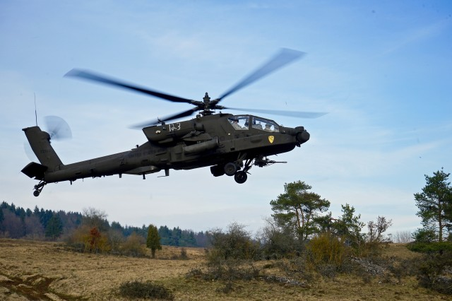 An AH-64 Apache attack helicopter crew with the 1st Attack Reconnaissance Battalion, 227th Aviation Regiment, 1st Air Cavalry Brigade, 1st Cavalry Division, takes off from the tactical airfield inside the Hohenfels Training Area, Germany during Allied Spirit VIII, Jan. 26, 2018. Allied Spirit VIII is a multinational exercise with over 4,100 participants from 10 nations that is designed to enhance interoperability among participating militaries and improve the U.S. military's readiness.