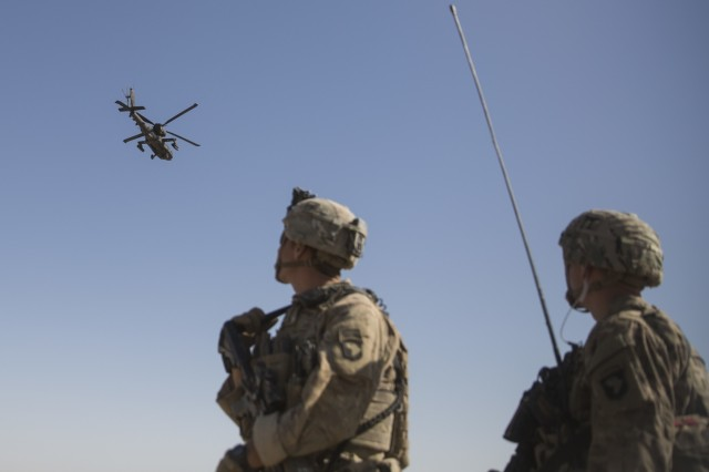 An AH-64 Apache attack helicopter provides security while CH-47 Chinooks drop off supplies to Soldiers with Task Force Iron at Bost Airfield, Afghanistan, in June 2017. The Soldiers' mission is to provide accurate fires capabilities in support of Task Force Southwest and Afghan national defense and security forces during current operations. One of the objectives of the ExPED STO is to identify sensor solutions with scalable open architectures that will adapt to the echelon in which they will operate in a tactical environment, thus facilitating integration with other ISR systems and the sharing of valuable information using the proper security boundaries. (U.S. Marine Corps photo by Sgt. Justin T. Updegraff, Resolute Support Headquarters)