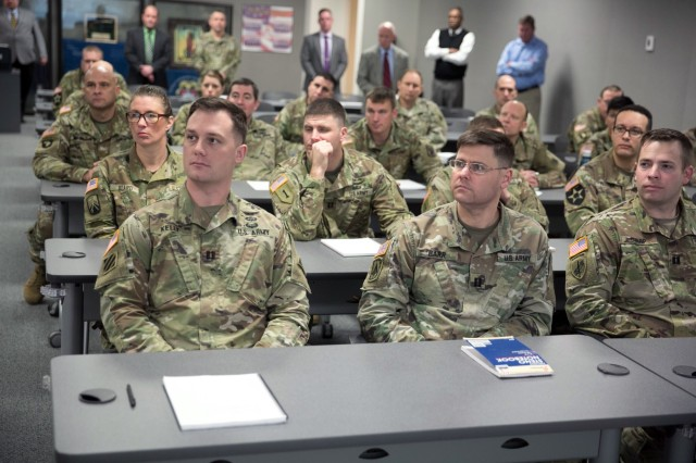 Students of the Command and General Staff College listen to Army Materiel Command commanding general Gen. Gus Perna during a visit to the resident course at Redstone Arsenal, Alabama, Jan. 26, 2018. Perna took the opportunity to provide direct guidance and mentorship to newly promoted field grade officers. The course is taught by the U.S. Army Command and Staff School and provides masters-level curriculum and instruction to U.S. Army Majors. (U.S. Army photo by Sgt. 1st Class Teddy Wade)