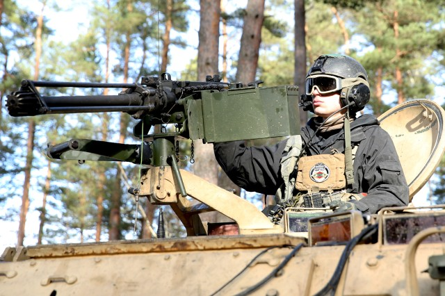 U.S. Army Spc. Jacob Henriksen, an infantryman assigned to 1st Battalion, 4th Infantry Regiment, mans a .50 caliber machinegun as his M113 Armored Personnel Carrier crew provides over watch at the 7th Army Training Command's Hohenfels Training Area, Hohenfels, Germany, during Allied Spirit VIII, Jan. 31, 2018. Allied Spirit VIII includes approximately 4,100 participants from 10 nations, Jan. 15-Feb. 5, 2018. Allied Spirit is a U.S. Army Europe-directed multinational exercise series designed to develop and enhance NATO and key partner's interoperability and readiness.