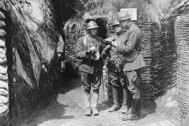 U.S. Army African American Soldiers of the 369th Infantry Regiment learn from French mentors in trench warfare in an undated photo during WWI. The 369th Infantry, an all-Black combat unit, served with distinction under French command in WWI and received the nickname 'Hell Fighters of Harlem' from their German enemies.