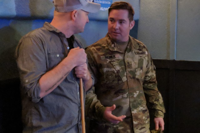 Sgt. 1st Class Tyson Regier, assigned to 1st Squadron, 89th Cavalry Regiment, 2nd Brigade Combat Team, 10th Mountain Division (LI), serves on the courtesy patrol Jan. 23 and talks with a 1st Brigade Combat Team Soldier in between shots on the pool table.