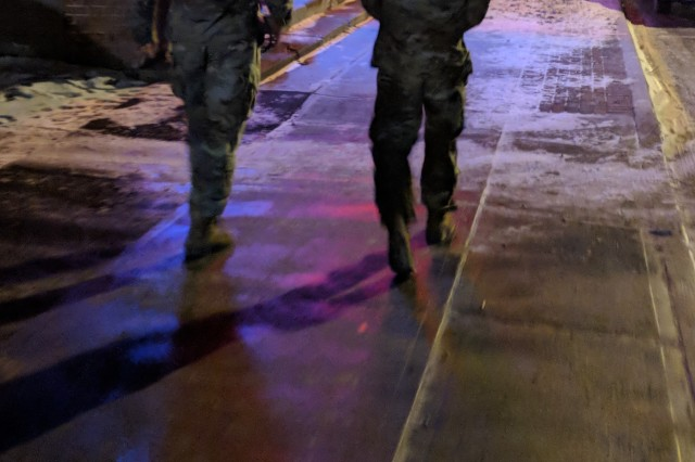 Sgt. 1st Class Tyson Regier and 1st Lt. Joseph Winckel, assigned to 1st Squadron, 89th Cavalry Regiment, 2nd Brigade Combat Team, heads to the next establishment as they conduct courtesy patrol duties Jan. 26 outside Fort Drum.