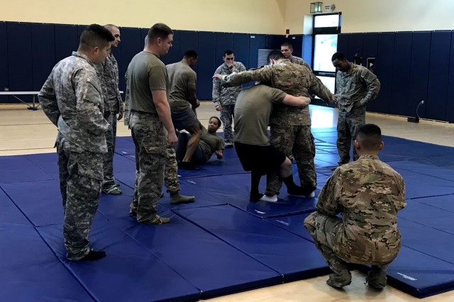 Soldiers practiced Combatives techniques, including Mixed Martial Arts and grappling techniques as part of the 2nd NATO Signal Battalion's Combatives Level I Training at the Naval Support Site Naples gym Jan. 15-19. (photo by Staff Sgt. Devika Evans, DCM A, 2nd NATO sig. Bn.)