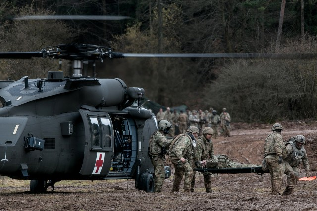 Medics from 557th Medical Company, 421st Medical Battalion, 30th Medical Brigade, Baumholder, Germany, conduct rapid medical evacuation training Jan. 29, 2018 during Allied Spirit VIII at Hohenfels Training Area, Germany. Roughly 4,100 troops from 10 nations are participating in Allied Spirit VIII, a multinational training exercise designed to test participants' readiness and capabilities.