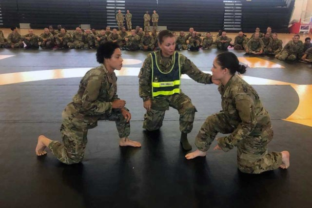 Drill Sergeant (Staff Sgt.) Jade Hill (center), also master combative instructor, directs basic combat trainees during a combative event in 2017 here. Hill was selected by a team of drill sergeants from Fort Jackson, S.C., to attend a drill sergeant leader course in February.