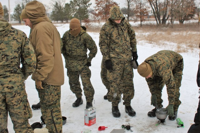 Marines with units associated with the 2nd Marine Aircraft Wing learn how to use camp stoves used in the Cold-Weather Operations Course (CWOC) on Jan. 24, 2018, at Fort McCoy, Wis. All were students in CWOC Class 18-03. During CWOC, students are trained on a variety of cold-weather subjects, including skiing and snowshoe training as well as how to use ahkio sleds and other gear. Training also focuses on terrain and weather analysis, risk management, cold-weather clothing, developing winter fighting positions in the field, camouflage and concealment, and numerous other areas that are important to know in order to survive and operate in a cold-weather environment. The training is coordinated through the Directorate of Plans, Training, Mobilization and Security at Fort McCoy. (U.S. Army Photo by Scott T. Sturkol, Public Affairs Office, Fort McCoy, Wis.)