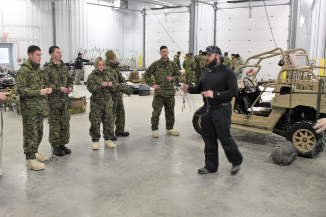 Marines with units associated with the 2nd Marine Aircraft Wing learn knot-tying techniques from instructor Hunter Heard during training in the Cold-Weather Operations Course (CWOC) on Jan. 24, 2018, at Fort McCoy, Wis. All students were in CWOC Class 18-03. During CWOC, students are trained on a variety of cold-weather subjects, including skiing and snowshoe training as well as how to use ahkio sleds and other gear. Training also focuses on terrain and weather analysis, risk management, cold-weather clothing, developing winter fighting positions in the field, camouflage and concealment, and numerous other areas that are important to know in order to survive and operate in a cold-weather environment. The training is coordinated through the Directorate of Plans, Training, Mobilization and Security at Fort McCoy. (U.S. Army Photo by Scott T. Sturkol, Public Affairs Office, Fort McCoy, Wis.)