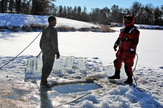 A Marine at Fort McCoy for the 2nd Marine Air Wing's Ullr Shield exercise participates in cold-water immersion training Jan. 17, 2018, on Big Sandy Lake at Fort McCoy, Wis. Ullr Shield is a training exercise designed to improve 2nd Marine Aircraft Wing's capabilities in extreme cold-weather environments. The 2nd Marine Aircraft Wing is headquartered at Marine Corps Air Station Cherry Point, N.C. Hundreds of Marines participated in the exercise at Fort McCoy. (U.S. Army Photo by Scott T. Sturkol, Public Affairs Office, Fort McCoy, Wis.)