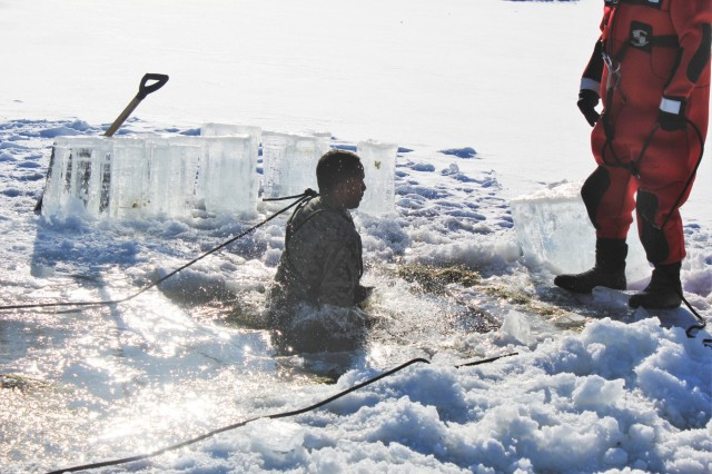 A Marine at Fort McCoy for the 2nd Marine Air Wing's Ullr Shield exercise participates in cold-water immersion training on Jan. 17, 2018, at Big Sandy Lake on South Post at Fort McCoy, Wis. Ullr Shield is a training exercise designed to improve 2nd Marine Aircraft Wing's capabilities in extreme cold-weather environments. The 2nd Marine Aircraft Wing is headquartered at Marine Corps Air Station Cherry Point, N.C. Hundreds of Marines participated in the exercise at Fort McCoy. (U.S. Army Photo by Scott T. Sturkol, Public Affairs Office, Fort McCoy, Wis.)