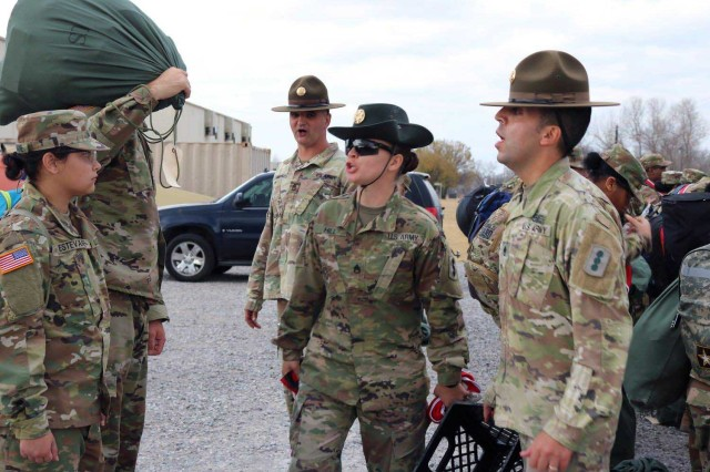 Staff Sgt. Jade Hill (center), a Drill Sergeant Leader Academy student candidate, instructs a basic combat trainee here. Hill was selected from a visiting panel of noncommissioned officers to attend a drill sergeant course at Fort Jackson, S.C., soon. She has been a drill sergeant just shy of a year.