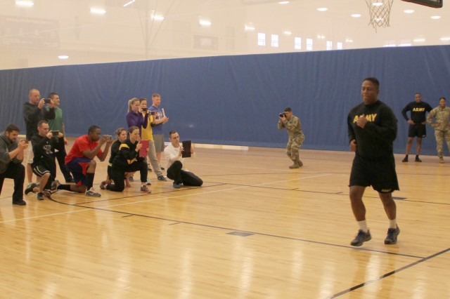 Master fitness trainers taking part in the Pose course film 1st. Sgt. Jose Douglas, Medical Company first sergeant, at the Fires Fitness Center.