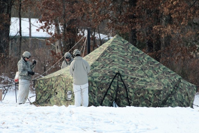 Students in the Fort McCoy Cold-Weather Operations Course 18-02 participate in building Arctic 10-person cold-weather tents as part of course operations Jan. 17, 2018, at Fort McCoy, Wis. During the course, students learn on a variety of cold-weather subjects, including skiing and snowshoe training as well as how to use ahkio sleds and other gear. Training also focuses on terrain and weather analysis, risk management, cold-weather clothing, developing winter fighting positions in the field, camouflage and concealment, and numerous other areas that are important to know in order to survive and operate in a cold-weather environment. The training is coordinated through the Directorate of Plans, Training, Mobilization and Security at Fort McCoy. (U.S. Army Photo by Scott T. Sturkol, Public Affairs Office, Fort McCoy, Wis.)
