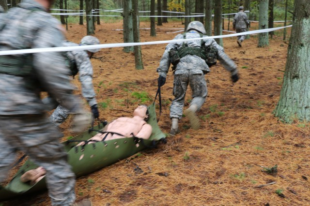 Cadets from Boston University evacuate a simulated casualty during the 2nd Brigade Ranger Challenge Oct. 14 at Fort Dix, N.J.