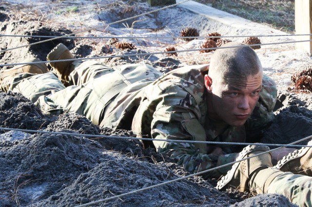 Florida State Cadets get a little dirty on the low crawl obstacle during the 6th Brigade Ranger Challenge held at Camp Blanding, Fla. Jan. 19.