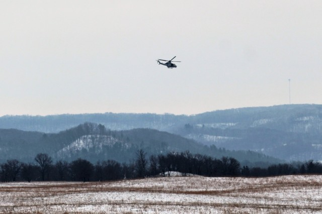 A Marine Corps UH-1Y Venom helicopter at the installation for the 2nd Marine Aircraft Wing's Ullr Shield exercise flies near Young Air Assault Strip on South Post on Jan. 24, 2018, at Fort McCoy, Wis. Ullr Shield is a training exercise designed to improve 2nd Marine Aircraft Wing's capabilities in extreme cold-weather environments from early January to early February 2018. The 2nd Marine Aircraft Wing is headquartered at Marine Corps Air Station Cherry Point, N.C. Hundreds of Marines participated in the exercise at Fort McCoy. (U.S. Army Photo by Scott T. Sturkol, Public Affairs Office, Fort McCoy, Wis.)