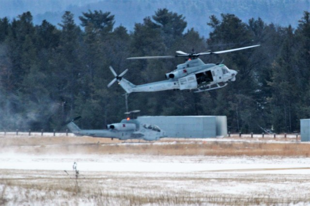 Two Marine Corps UH-1Y Venom helicopters at the installation for the 2nd Marine Aircraft Wing's Ullr Shield exercise operate at Young Air Assault Strip on South Post on Jan. 24, 2018, at Fort McCoy, Wis. Ullr Shield is a training exercise designed to improve 2nd Marine Aircraft Wing's capabilities in extreme cold-weather environments from early January to early February 2018. The 2nd Marine Aircraft Wing is headquartered at Marine Corps Air Station Cherry Point, N.C. Hundreds of Marines participated in the exercise at Fort McCoy. (U.S. Army Photo by Scott T. Sturkol, Public Affairs Office, Fort McCoy, Wis.)