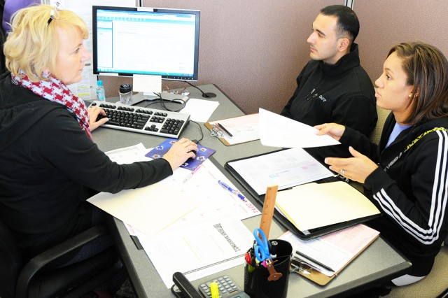 Gail Evelyn, tax preparer at the Fort Rucker Tax Center, helps CW2 Ralph Hernandez and his wife, Brittany, with their tax return in this file photo.