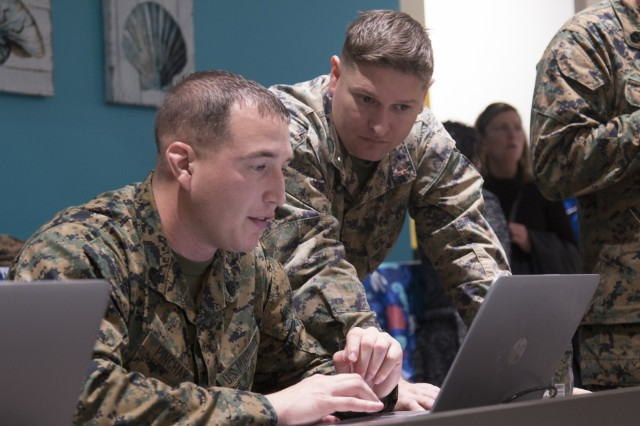 Staff Sgt. Robert Pinchak and Chief Warrant Officer 3 Daniel Matthews, with the 2nd Maintenance Battalion at Camp Lejeune Marine Corps Base, North Carolina, work on one of the computers set up for use for Soldiers and their Family Members in the newly opened USO facility on Fort Stewart, Georgia, Feb. 1, 2018. The new 14,000 square-foot facility, located behind the Popeye's on Gulick Avenue on main post, features seven televisions, a projection screen, foosball, pool tables, an Xfinity game room, wireless internet capabilities, computers available for use and donated refreshments for visitors. (U.S. Army photo by Spc. Noelle E. Wiehe, 50th Public Affairs Detachment, 3rd Infantry Division/ Released)