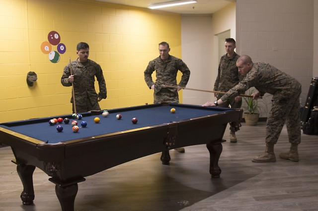 U.S. Marines with the 2nd Maintenance Battalion at Camp Lejeune Marine Corps Base, North Carolina, shoot pool during the grand opening event of the new Fort Stewart, Georgia, USO facility Feb. 1, 2018. USOs were established prior to the onset of America's involvement in World War II in 1941 by Franklin D. Roosevelt to unite several service associations into one organization to lift the morale of our military and nourish support on the home front. (U.S. Army photo by Spc. Noelle E. Wiehe, 50th Public Affairs Detachment, 3rd Infantry Division/ Released)
