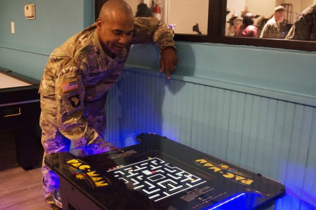 Lt. Col. Fran Marks, commander, 3rd Battalion, 15th Infantry Regiment, plays Pac-Man in the Xfinity Game Room within the new USO facility, opened Feb. 1, 2018, on Fort Stewart, Georgia. The new 14,000 square-foot facility, located behind the Popeye's on Gulick Avenue on main post, features seven televisions, a projection screen, foosball, pool tables, an Xfinity game room, wireless internet capabilities, computers available for use and donated refreshments for visitors.  (U.S. Army photo by Spc. Noelle E. Wiehe, 50th Public Affairs Detachment, 3rd Infantry Division/ Released)