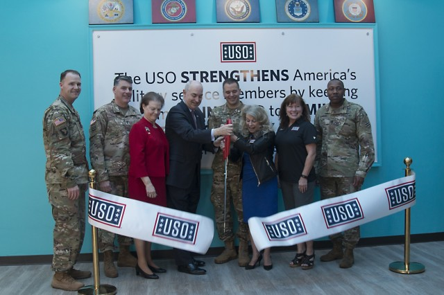 Leaders of the 3rd Infantry Division and USO representatives cut the ribbon to officially open the new Fort Stewart, Georgia, USO location Feb. 1, 2018. USOs were established prior to the onset of America's involvement in World War II in 1941 by Franklin D. Roosevelt to unite several service associations into one organization to lift the morale of our military and nourish support on the home front. (U.S. Army photo by Spc. Noelle E. Wiehe, 50th Public Affairs Detachment, 3rd Infantry Division/ Released)