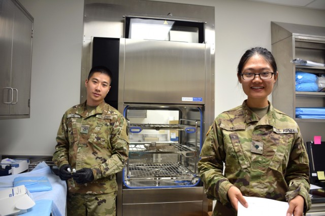 Dental Specialist Pfc. Jianhang Yao, left, and Dental Assistant Spc. Jianhong Hu, right, assigned to Dental Health Activity - Hawaii, work to set up a lab at the Fort Shafter Dental Clinic, Jan. 19, 2018.