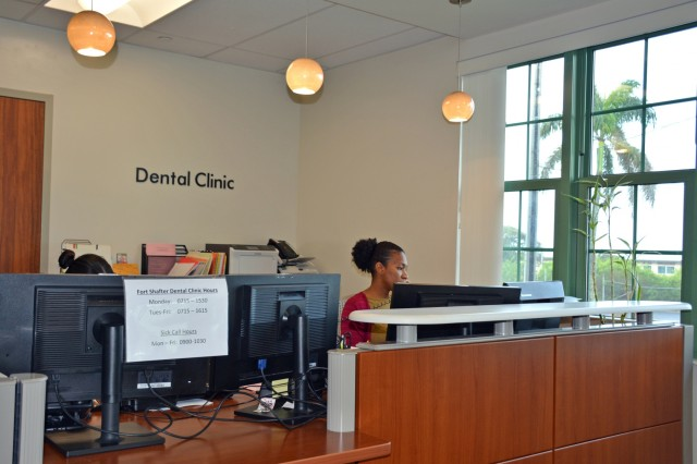 Tiffani Davis answers patient calls at the Fort Shafter Dental Clinic, Jan. 19, 2018.