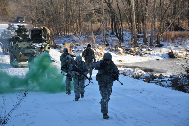 Capt. David Glisson, Company B, 554th Engineer Battalion, leads Engineer Basic Officer Leader Course students in a field training exercise along the Roubidoux Creek, Jan. 17, 2018, during a visit from the Defense Media Activity, Fort Meade, Maryland. DMA visited Fort Leonard Wood to highlight Army engineer careers and training.
