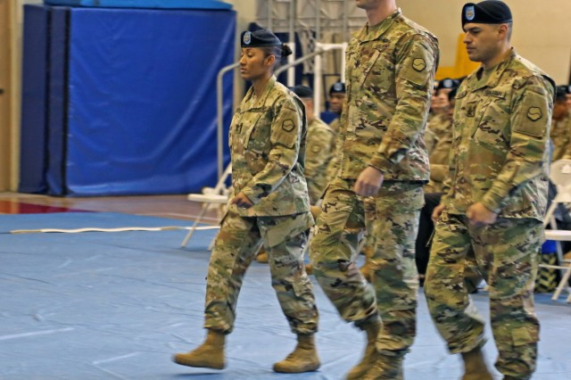 1st Sgt. Johanna Y. Castro (Left), the outgoing senior enlisted leader of Headquarters and Headquarters Company, 19th Expeditionary Sustainment Command, and a native of San Pedro de Macoris, Dominican Republic, marches alongside Capt. Michael C. King (Center), commander of HHC, 19th ESC, and a native of Mount Vernon, Ohio and Sgt. Cristian G. Solano (Right), the incoming senior enlisted leader of HHC, 19th ESC, and a native of Loja, Ecuador, during a change of responsibility ceremony, Jan. 30 at the Kelly Fitness Center, Camp Walker, Daegu. Korea.