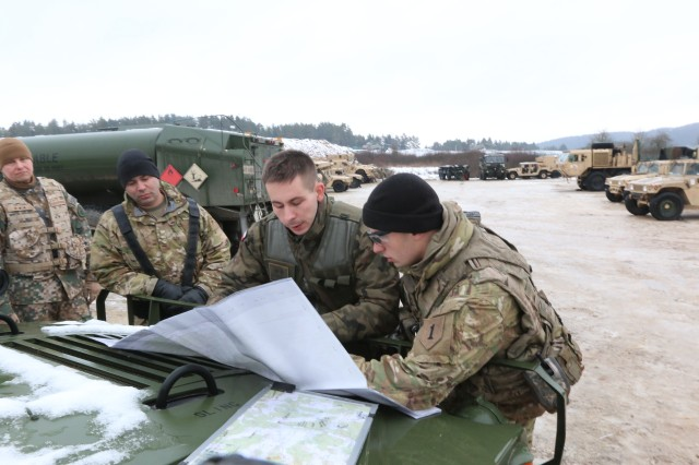 Soldiers from 82nd Engineer Battalion, 2nd Armored Brigade Combat Team, 1st Infantry Division and a Polish soldier discuss their convoy route out to their site to practice chemical, biological, radiological, nuclear and explosive response operations in preparation for Allied Spirit VIII Jan. 22, 2018 in Hohenfels, Germany. Allied Spirit VIII is designed to provide multinational interoperability training at brigade and battalion levels to enhance U.S. and NATO effectiveness. (U.S. Army photo by Staff Sgt. Wallace Bonner)