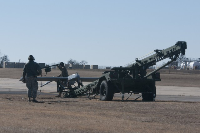 "Members of Det. 1, Delta Company, 545th Brigade Engineer Battalion, 45th Infantry Brigade Combat Team, Oklahoma Army National Guard, brave the below freezing temperatures to conduct their required Additional Flight Training Period (ATFP) hours with the RQ-7 Bravo or  ""Shadow"" at Muldrow Army Heliport in Lexington, Oklahoma, Jan. 29. This is the first time the operators and maintainers of the Unmanned Aircraft System (UAS) conducted training at Lexington."
