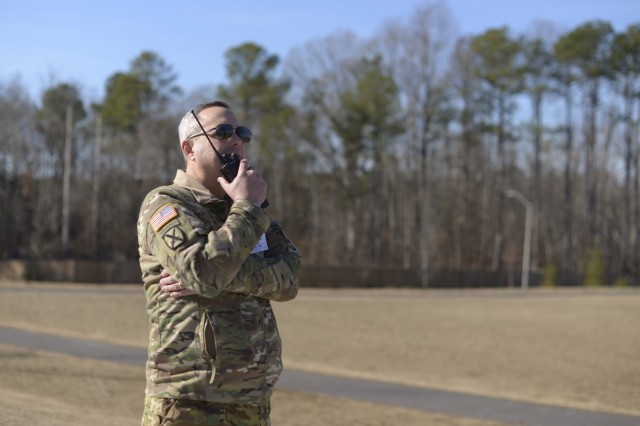 Lt. Col. Benny Collins, commander of the 1-130th Attack Reconnaissance Battalion, 449th Theater Aviation Brigade talks to the crew of an incoming UH 72 Lakota Helicopter at Rogers Lane Elementary School in Raleigh, North Carolina, January 31, 2018. After the helicopter landed, students were brought out to the field and given an opportunity to ask questions and get a close-up look of the aircraft.