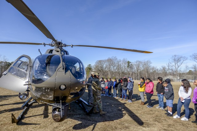 Soldiers with the 449th Theater Aviation Brigade, answer questions from students at Rogers Lane Elementary School in Raleigh, North Carolina, January 31, 2018. Soldiers from the unit landed a UH 72 Lakota Helicopter on the school's field and talked to students about how helicopters work, and the math and reading skills needed to be a pilot.