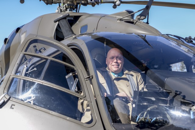 Shane Barham, the principle of Rogers Lane Elementary School in Raleigh, North Carolina, sits in a UH 72 Lakota Helicopter parked on the school's field, January 31, 2018. The school hosted the North Carolina National Guard helicopter and its crew as part of an enrichment program for the students. Soldiers answered questions about the aircraft and talked about the reading and math skills needed to both fly and conduct maintenance on helicopters.