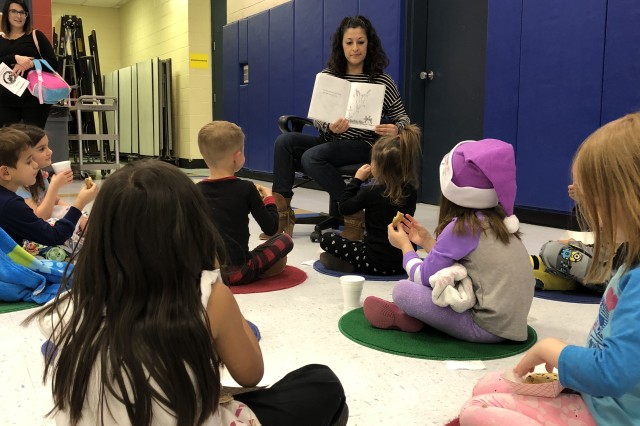 Students and Family member read and listen to books during the Pierce Terrace Elementary School's Literacy Night, Jan. 25. The Literacy Night offered students and their Families the opportunity to experience reading in a different way.