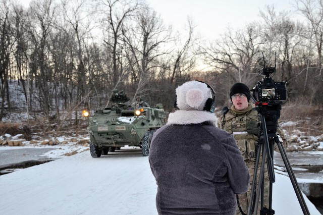 Kayla Cain, Defense Media Activity, Army Media Gold Team, multimedia producer, interviews Capt. David Glisson, Company B, 554th Engineer Battalion, about officer training for Army Engineers following the Engineer Basic Officer Leader Course field training exercise along the Roubidoux Creek at Fort Leonard Wood, Jan. 17, 2018.