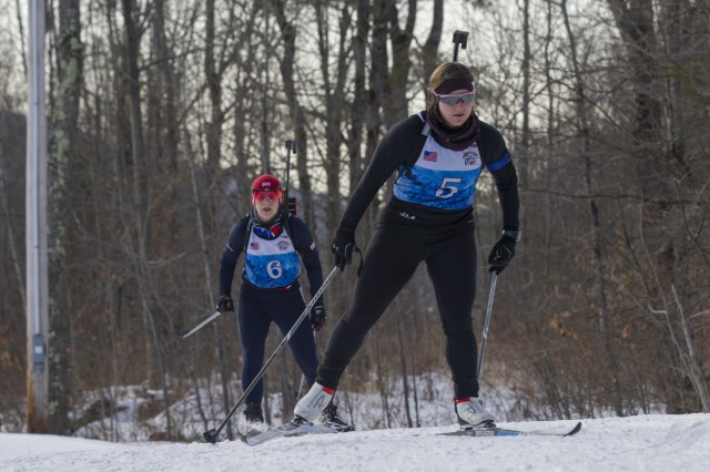 U.S. Army Staff Sgt. Ashley Anderson, right, Missouri National Guard, and Capt. Lauren Weber, Ohio National Guard Biathlon Team, compete in a sprint race at Camp Ethan Allen Training Site, Jericho, Vt., Jan. 27, 2018. Athletes from 24 states participated in the National Guard Eastern, Western, and Central Regional Biathlon Competitions.