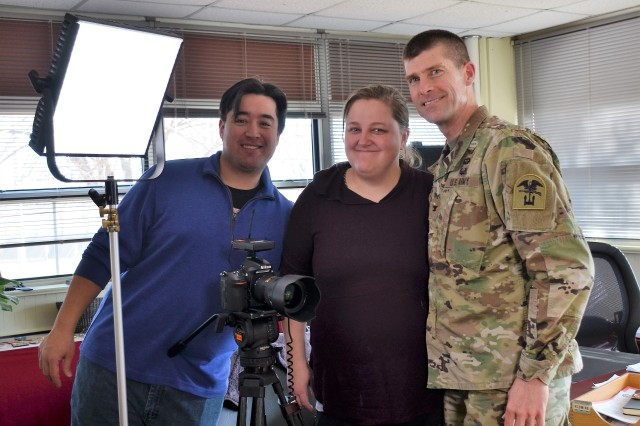 Col. Dale Snider, 1st Engineer Brigade commander, poses for a photo with Devon Suits, left, and Kayla Cain, both with Defense Media Activity's Army Media Gold Team, following an interview about the Army engineer profession, Jan. 19, 2018, at Fort Leonard Wood.