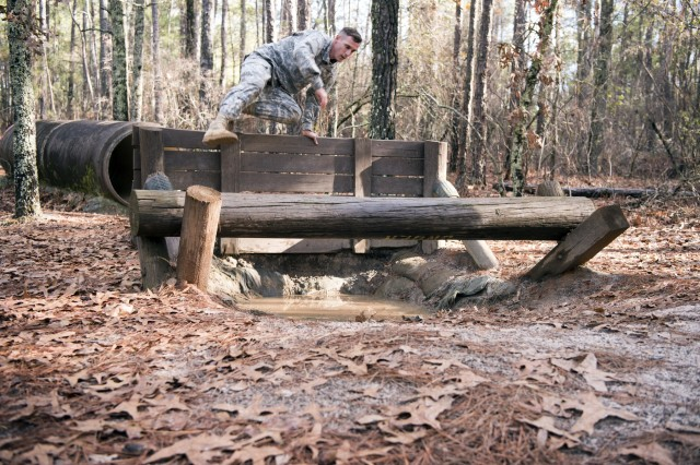 Sgt. Jake Chupp, bridge crew member, 125th Multi Role Bridge Company, vaults an obstacle during the South Carolina Army National Guard Best Warrior competition at the Fit to Win obstacle course, Fort Jackson, South Carolina, Jan. 29. Cupp, a native of Seneca, South Carolina, has been a member of the South Carolina Army National Guard for seven years.