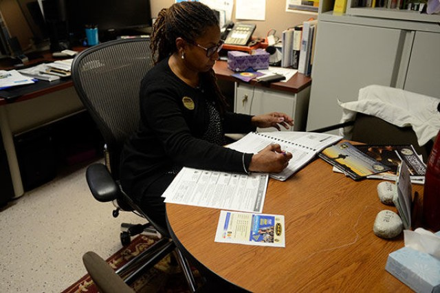 """In preparation for Army Community Service's upcoming """"Keeping it R.E.A.L."""" class 9-10 a.m. Feb. 14 at ACS, 2601 Indiana Ave., P.J. Rawlins, ACS-Family Advocacy Program specialist, reads from her copy of the Master Resilience Training Trainer manual Monday in her office at ACS. The Feb. 14 class will focus on """"Being the Best of Who You Are."""""""